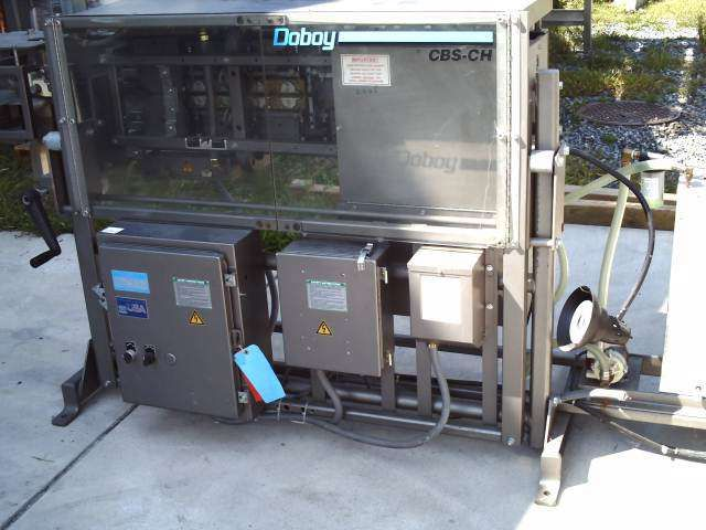 Doboy Horizontal Bag Sealer with deflating transport conveyor