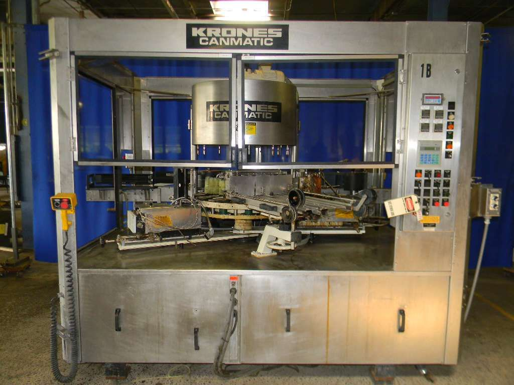 Krones 12 Head Rotary Hot Melt Cut and Stack Labeler