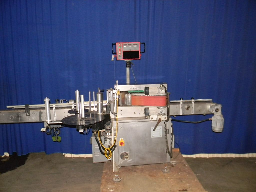 Harland Inline Wrap Labeler with Vertical Roller Carriage