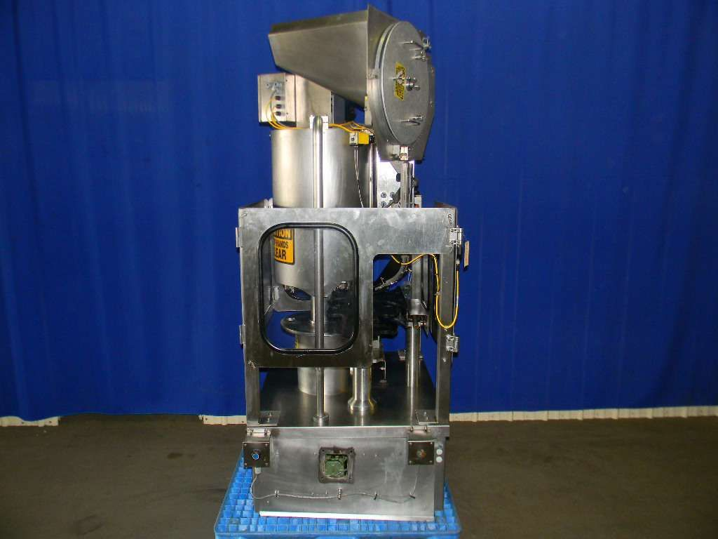 National Instrument 4 head Rotary West or Genesys Style Closure Machine