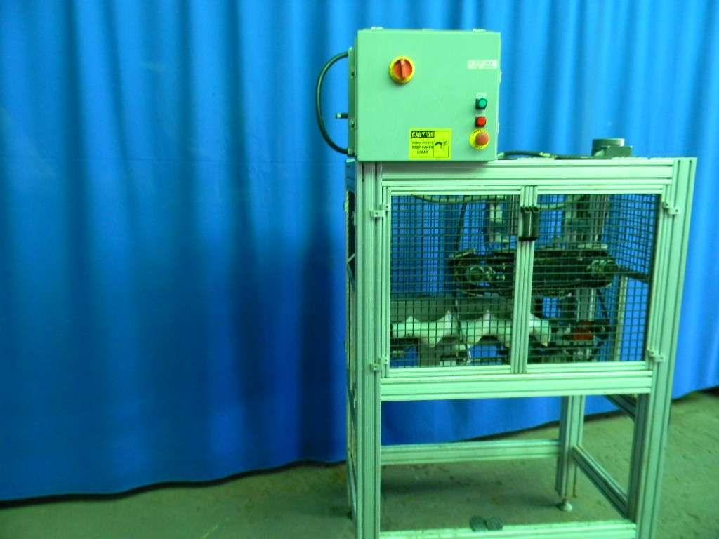 Morrison Lid Press Machine