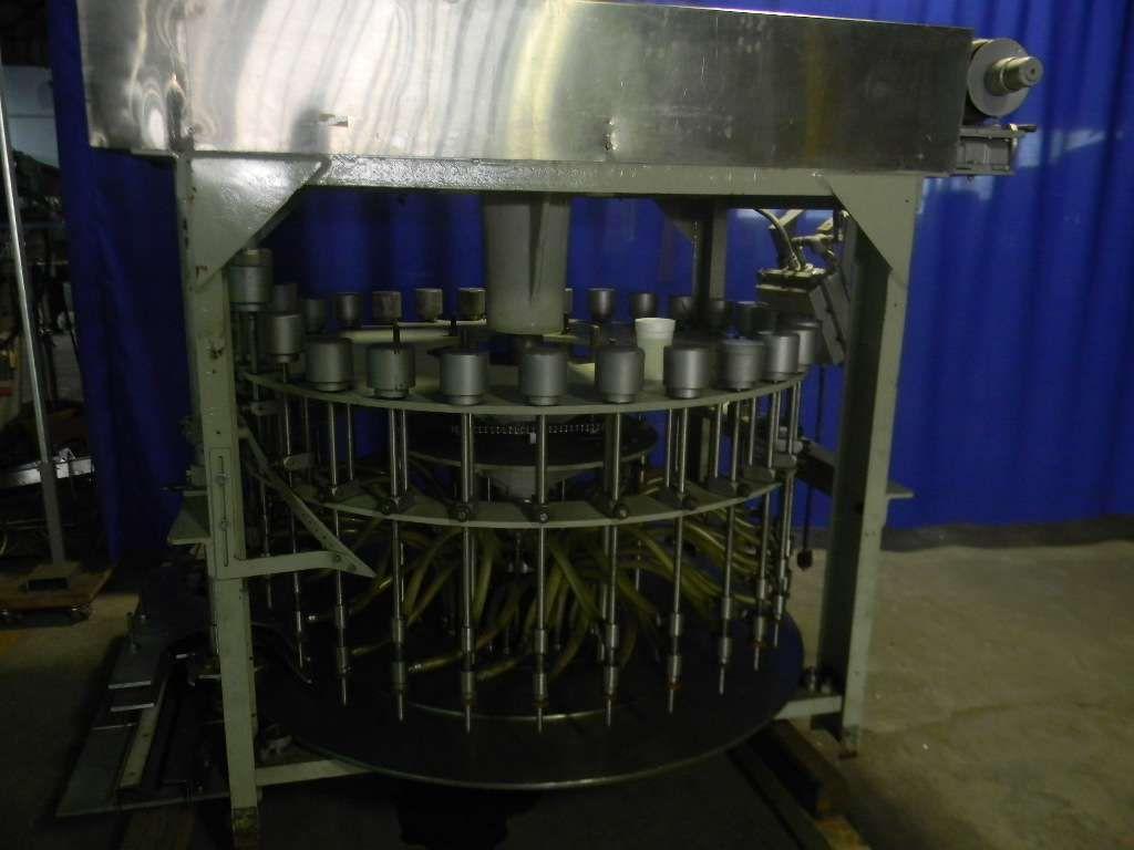MRM Husky 30 Head Rotary Pressure Overflow Filler