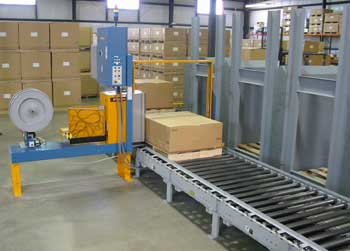 Pallet strapping equipment